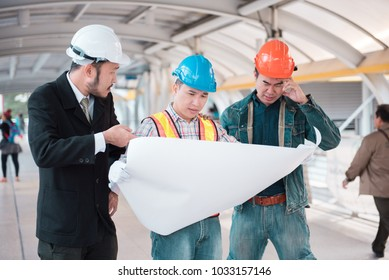 Engineers looking at blueprints with business people To build a building,Successful team with construction on site work.