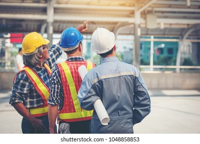 Engineers looking at construction On the BTS station