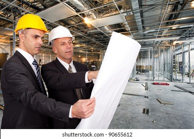 Engineers looking at a plan on a construction site