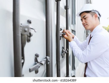 Engineers man checking equipment while working at constructions site. Copy space.