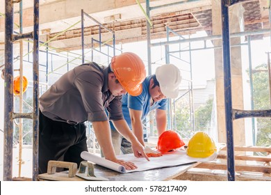 Engineers and meetings, conversations with a blueprint for the construction work