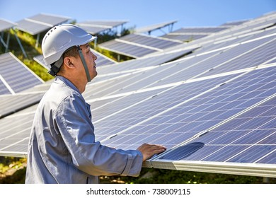 Engineers in the outdoor inspection solar photovoltaic panels