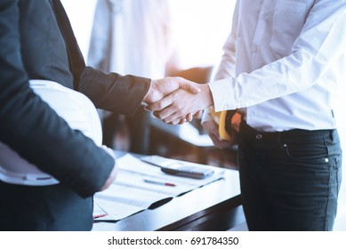 Engineers shaking hands agreement partners to work in conference Business negotiations