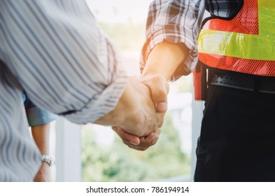 engineers and technician contractor shaking hands after finishing up a business meeting to greeting start up project contract in construction site building, successful, partnership, teamwork concept