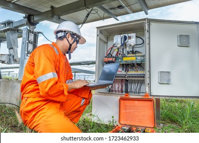 Engineers upload data of power energy to a laptop for checking the performance of the solar panel to confirming systems working normally. Concepts professional engineer for the Solar cell power plant.