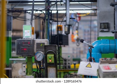 Engineers use the sound level meter to measure the volume of the generator and recording data. noise in laboratory room with a sound level meter Industrial area factory