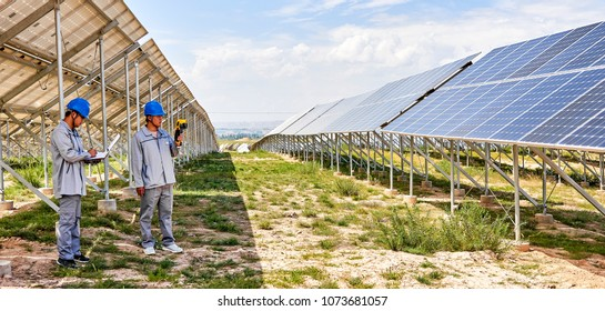 Engineers using professional tools to test in the solar PV area