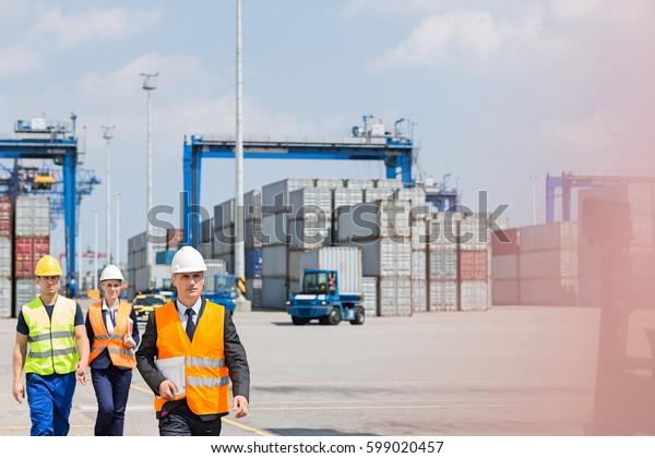 Engineers walking in shipping yard