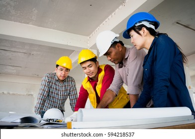 Engineers wearing safety helment meeting and discuss for work planning on site
