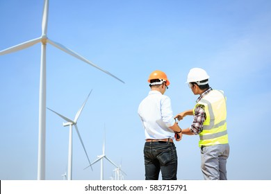 Engineers windmills for production of electric power.