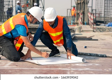 Engineers and workers on the construction site