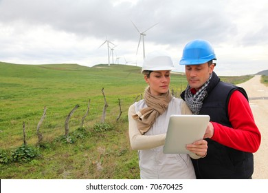 Engineers working with electronic tablet