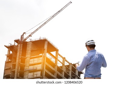 Engineers are working on plans to build high-rise buildings. Engineer building concept.