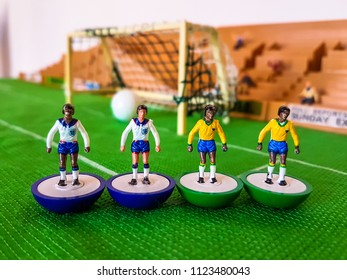 England and Brazil football figures lined up on a grass field