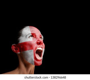 The England flag on the face of a screaming woman. concept