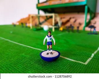 England football figure lined up on a grass field