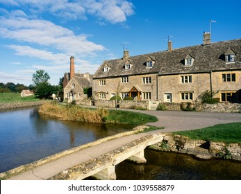 England, Gloucestershire, Cotswolds, picturesque cotswold stone cottages by the River Eye in Lower Slaughter
