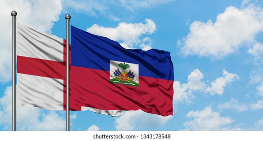b745478d9 England and Haiti flag waving in the wind against white cloudy blue sky  together. Diplomacy