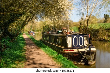 England - Inland Navigation. Barge moored on a stretch of the Grand Union Canal near Leamington Spa, in Warwickshire, England, United Kingdom.
