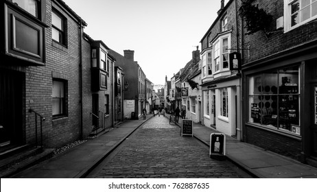 England, Lincoln - Nov 16, 2017: Looking Down The Strait, Old Medieval Narrow Streets, Black and White Street Photography