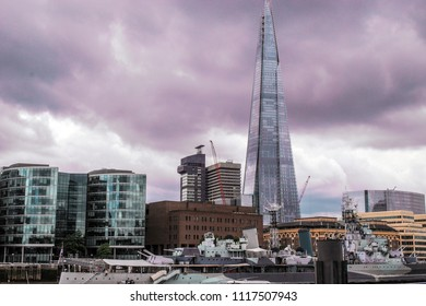 England, London, may 30, 2017. The glass shard building at London bridge on cloudy day. The highest building in Europe. Beautiful purple clouds.