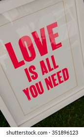 England, Morecambe, 07/14/2015, love is all you need screen printed and framed behind glass