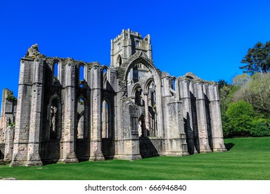 England, North Yorkshire, Ripon. Fountains Abbey, Studley Royal. UNESCO World Heritage Site. Cistercian Monastery. Ruins of Tower and Chapel of Altars. - Shutterstock ID 666946840