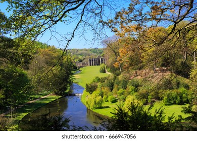 England, North Yorkshire, Ripon. Fountains Abbey, Studley Royal. UNESCO World Heritage Site. Cistercian Monastery. River Skell and Surprise view.