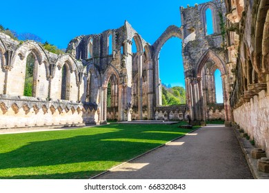 England, North Yorkshire, Ripon. Fountains Abbey, Studley Royal. UNESCO World Heritage Site. Cistercian Monastery. Ruins of Church Abbey arches. 2017-05-03
