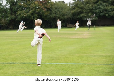 England school youth player warming up for village cricket game in the UK in summer