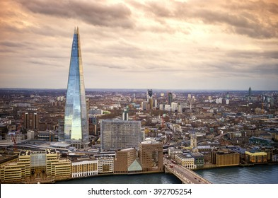England - Skyline of South London with London Bridge, Shard skyscraper and River Thames - United Kingdom with beautiful golden sky