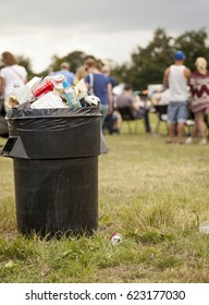 England , Staffordshire - July 28 2013: A black bin-full of trash in an open field at the Staffordshire county show.