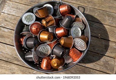 England, UK. 2021.  Used coffee capsules ready for the aluminium  tops to be  recycled