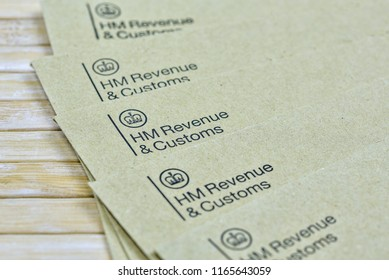 England, UK - August 16 2018: The logo of Her Majestys Revneue and Customs on a envelope. HMRC is a non-ministerial dept of the UK Government. Editorial.