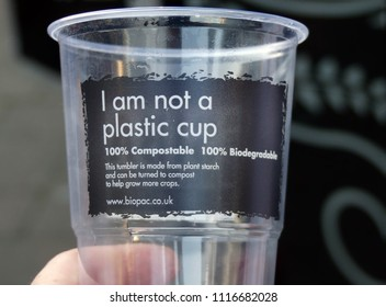 England, UK - June 2 2018: An eco friendly plastic cup, that is made form an alternative material. Relevant to plastic waste and pollution