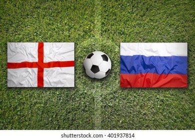 England vs. Russia flags on green soccer field