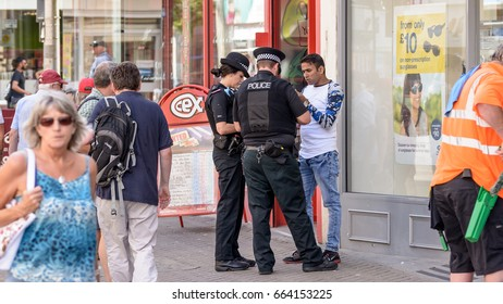 England, Weston-super-Mare - June 19, 2017: Police Officers taking notes with a member of the public