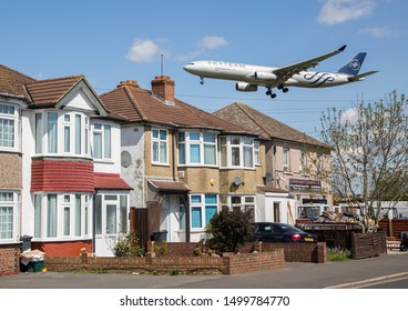 England/London March 12th 2019 Planes landing at London Heathrow Airport. An Aeroflot Airbus A330 plane flies over residential houses as it approaches Southern runway before landing