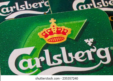 ENGLAND,LONDON - November 11, 2014:Beermats from Carlsberg beer.The Carlsberg is a Danish brewing company founded in 1847 by J. C. Jacobsen with headquarters located in Copenhagen,Denmark