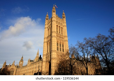 England's Parliament building with deep blue skies rises above Westminster. There's a glimpse of the famous Big Ben, as well.