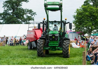 ENGLEFIELD,UK-MAY 28,2017:As part of the agricultural theme of the show, a vintage tractor gives a display in the main arena to the public at the Berkshire fair on May 28,2017.
