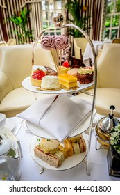 English afternoon tea set with the selection of pastry and dessert, London, UK