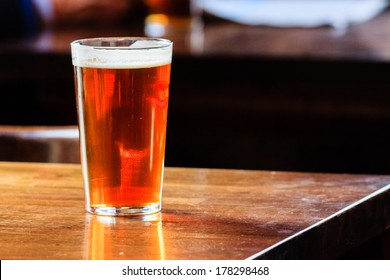 An english ale on a wooden table in a pub in London, UK