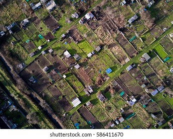 English allotments, aerial view. Aerial drone photo looking down vertically onto a full-frame typical English allotments ground lying fallow in February.