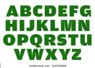 English alphabet created with green grass with a little shadow.