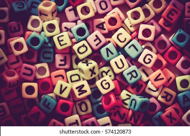 English alphabet cube as background, retro color tone