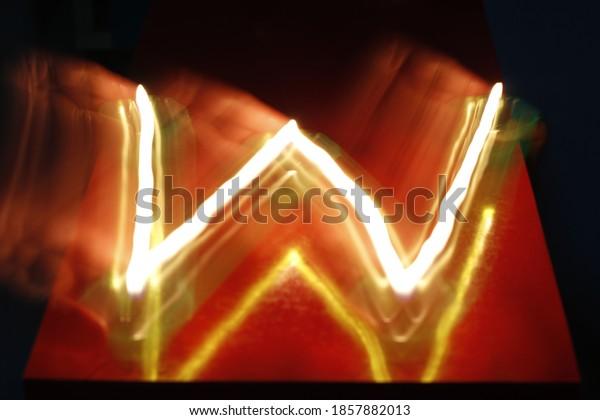 English alphabet with Diya/ lamp. English alphabet made with lamp on slow shutter speed