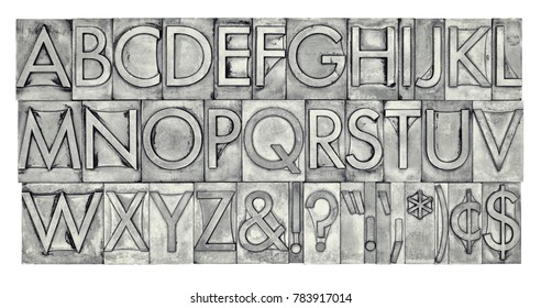 English alphabet, dollar, cent and punctuation signs in vintage metal type, black and white image with platinum toning