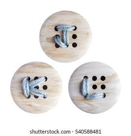English alphabet of embroidery on wooden botton