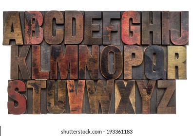 English alphabet in letterpress wood type printing blocks, stained by color inks